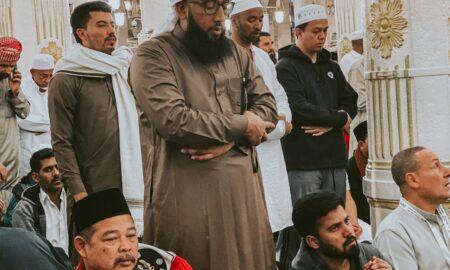 man stands in prayer