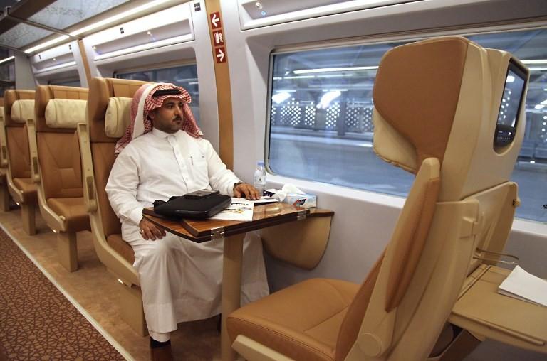 Saudi passenger on a train to Mecca