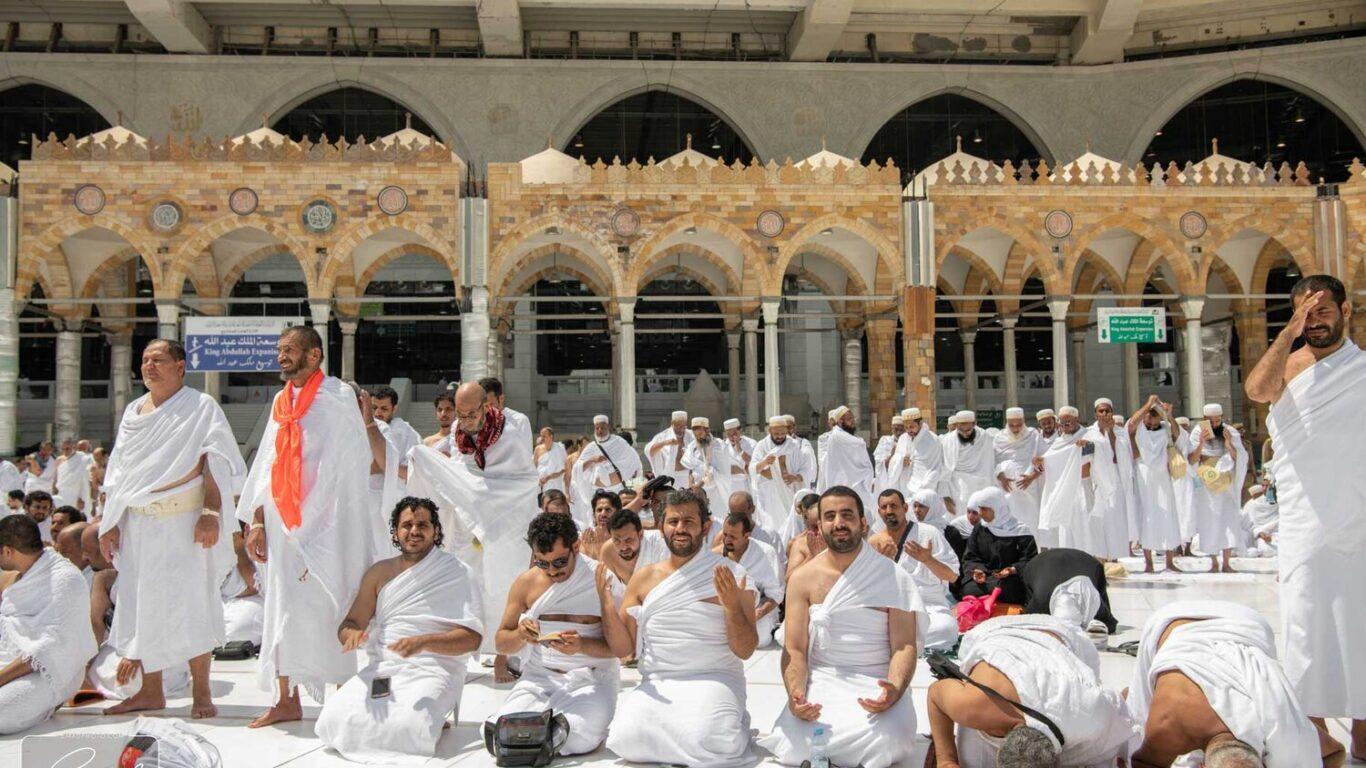 many pilgrims sitting down
