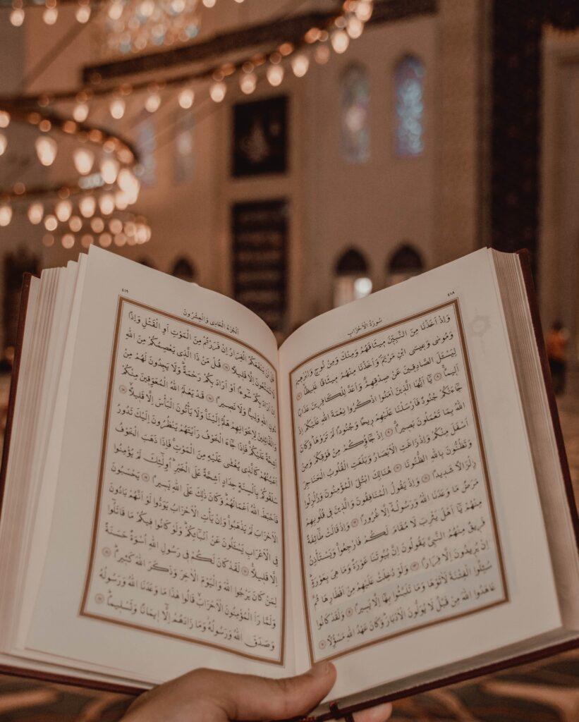 Hand holding Quran