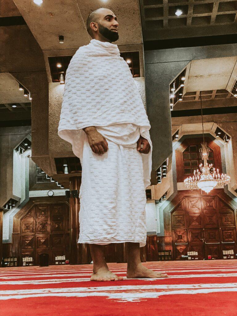 Muslim man praying at a mosque in saudi arabia